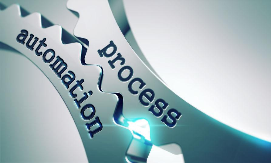 """Deux roues crantées avec l'inscription """"Process automation"""" c'est-à-dire: automatisation des process."""